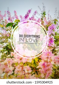 catholic quote do everything in love. 1 Corinthians 16:14 with blurred colorful flowers background.holy bible quote