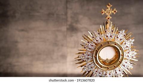 Catholic religion concept. Christianity symbols on gray stone background.