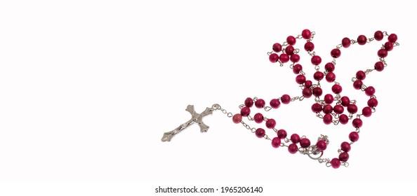 Catholic rosary and crucifix on white background