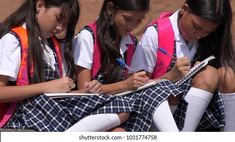Catholic School Children Writing Wearing School Uniforms