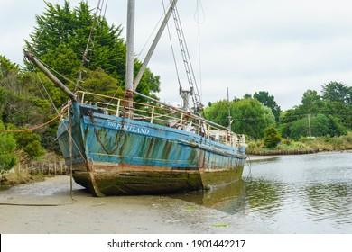 Catlins New Zealand - February 23 2015; Wreck of The Portland, old neglected scow beached in Owaka River in the Catlins, Otago, New Zealand.
