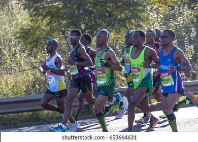 CATO RIDGE, DURBAN, SOUTH AFRICA : JUNE 4, 2017: Group of nine unknown African runners participate  in the Comrades Marathon between Durban and Pietermaritzburg in South Africa