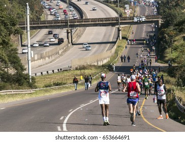 CATO RIDGE, DURBAN, SOUTH AFRICA : JUNE 4, 2017: Many unknown spectators and  runners participate  in the Comrades Marathon between Durban and Pietermaritzburg in South Africa