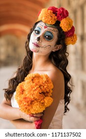 Catrina in cemetery with wedding dresses in an old cemetery of Guadalajara, Mexico.