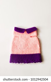 Cat's knitted clothes, Cat's crochet clothes with sweet color on white wall background and soft light.