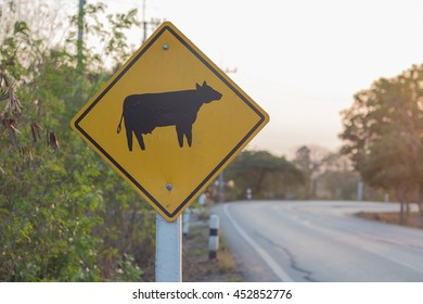 The cattle traffic warning sign on the side of the road.