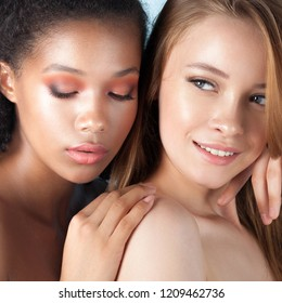 Caucasian and african teen girls close-up. Skin care and makeup. Mixed race beauty portrait