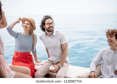 Caucasian attractive just married couple having their honeymoon trip on a luxury sailing boat at summer Carribean Sea
