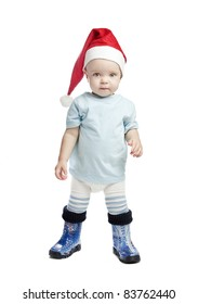 caucasian baby boy in a red christmas cap