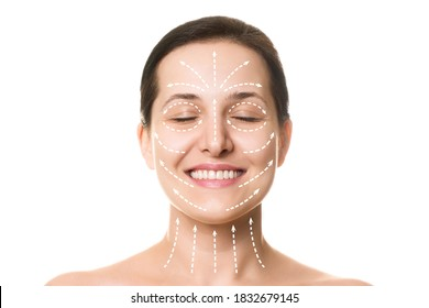 Caucasian beautiful female face with closed eyes, smile and hair up in a bun. Marked with arrows on the main facial lifting lines, front view, isolated on white. Rejuvenation procedure, beautician