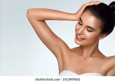 Caucasian beautiful girl holds hair in hand, raise up hands. Beauty young woman, salon body and armpit skin care, smooth armpit skin, hair removal and sugaring. Happy girl with closed eyes - Shutterstock ID 1913409061