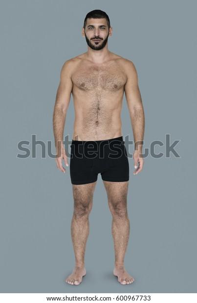 Caucasian Black Hair Male Model On Blue Background