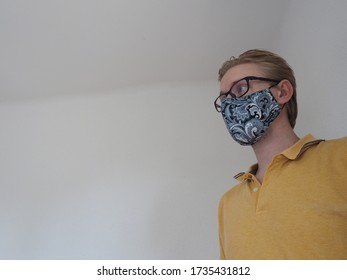 caucasian blonde Male with Mask and glasses at Corona times