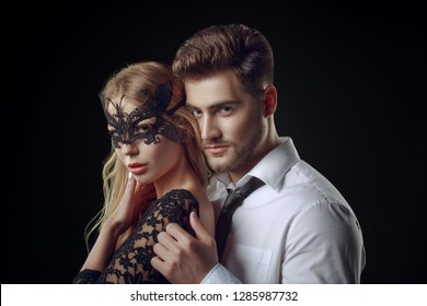 Caucasian blonde woman portrait with a lace black mask teasing an elegant man as in the movie Fifty Shades Darker, movie poster, commercial