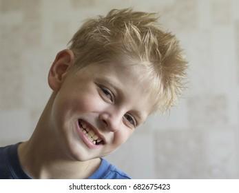 Caucasian boy with disheveled hair
