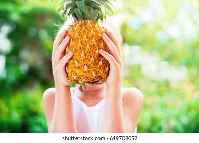 Caucasian Boy Hold Juicy Pineapple Hands Summer Green Background