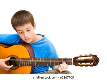 caucasian boy learning to play acoustic guitar, isolated on white background; horizontal crop