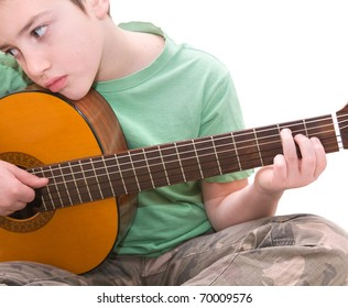 caucasian boy practicing  play acoustic guitar, being bored, isolated on white background