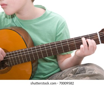 caucasian boy practicing; play acoustic guitar; being bored; isolated on white background