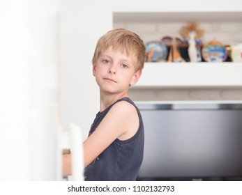 Caucasian boy standing in kitchen and looking at camera