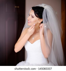 caucasian brunette bride is getting ready in  the morning