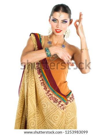 e8ebf82560 Caucasian brunette woman in brown indian national dress sari in studio on white  isolated background