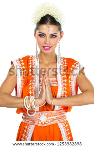 d0223089a3 Caucasian brunette woman in orange indian national dress sari in studio on white  isolated background