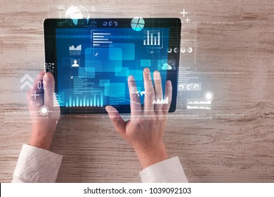 Caucasian business hands holding tablet with blue business-statistics screen