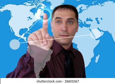A Caucasian business man is plotting points on a map of the Earth. The background is blue.
