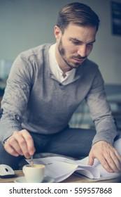 Caucasian business man working at his desk. Focus on Caucasian man.