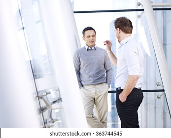caucasian business people talking having a discussion conversation in office.