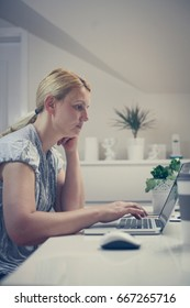 Caucasian business woman. Woman working in office using laptop.