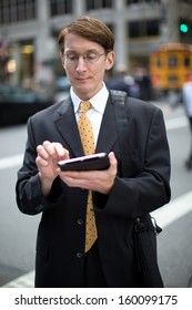 Caucasian businessman business man on New York City Park Avenue street tablet pc