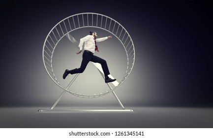 caucasian businessman run in abstract hamster wheele