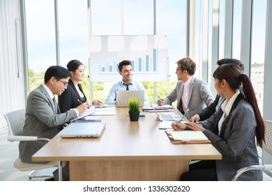 caucasian businessman showing success business profit graph from white board in meeting with smile and happy face