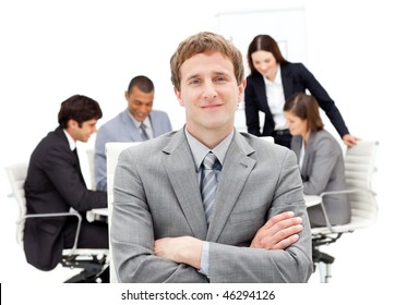 Caucasian businessman sitting in front of his team in a meeting