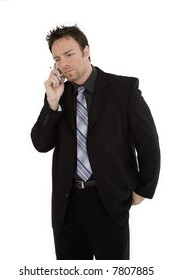 Caucasian businessman standing and talking on the cell phone