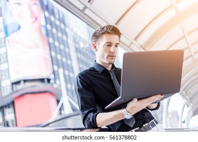 Caucasian businessman use of the notebook computer at outdoor