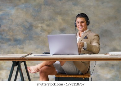 caucasian businessman wearing business suit with casual short pant working from home with laptop online for new normal business practise to keep social distancing