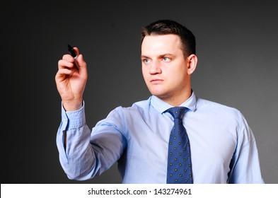 caucasian businessman is writing in air