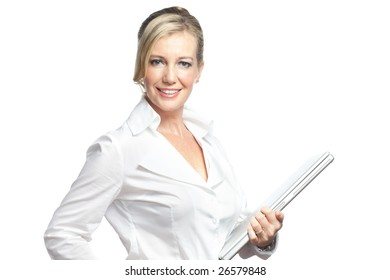Caucasian businesswoman dressed in business attire holding a laptop