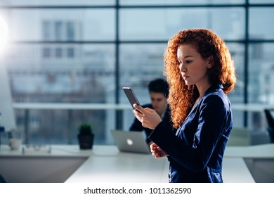 caucasian Businesswoman Outside Office On Mobile Phone