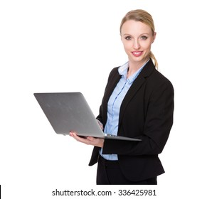 Caucasian Businesswoman use of the laptop computer