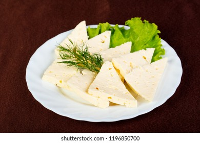 Caucasian cheese suluguni with salad leaves