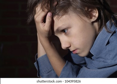Caucasian child frustrated sitting in a deserted place