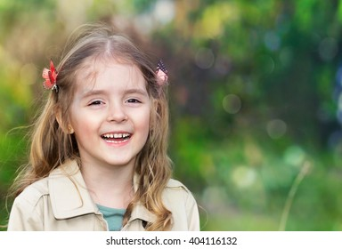 Caucasian child girl portrait outdoors empty copy space background.Female kid outside happy face smiling.