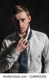 Caucasian concept. Caucasian man with serious face. Caucasian man wear shirt with tie. Handsome caucasian guy.