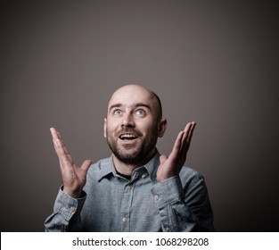caucasian confused excited bald man has unexpected idea