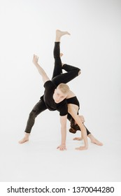 Caucasian Contemporary Couple Middle Level Pose. Man Dancer in Plie Looking at Camera. Attractive Perfomer in Black Denim and Top Isolated on White Background. Brunette Woman do Handstand