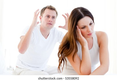 Caucasian couple argumenting against a white background